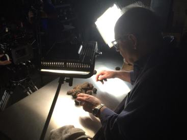 Tough work, but someone has to set up the shot and that requires every truffle be inspected prior to going on set.